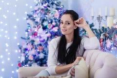 Happy woman near Christmas tree. Stock Photography