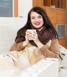 Happy woman near   electric heater Stock Photography