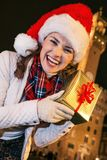 Happy woman near Palazzo Vecchio showing Christmas present box Royalty Free Stock Images