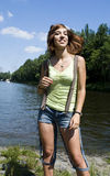 Happy woman near the river Royalty Free Stock Images