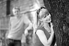 Happy woman near tree and her boyfrend Stock Image