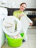 Happy woman near washing machine Stock Photography