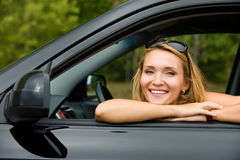 Happy woman in the new car Stock Photo