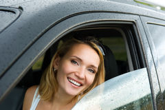 Happy woman in the new car Royalty Free Stock Photo