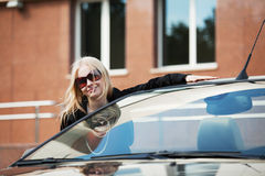 Happy woman with a new car Stock Photo