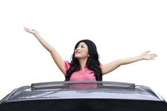 Happy woman in new car Stock Photo