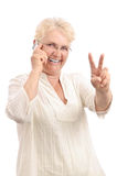 Happy woman with new cell phone Royalty Free Stock Photography