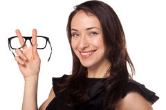 Happy woman with a new glasses at optics Royalty Free Stock Photos