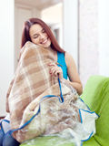 Happy woman with new plaid Stock Images
