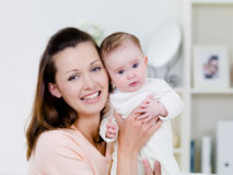 Happy woman with newborn child Stock Image