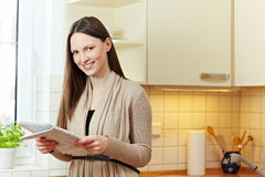 Happy woman with newspaper Royalty Free Stock Photography