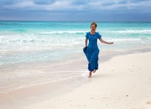 happy woman on an ocean coast Stock Photography
