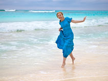The  happy woman on an ocean coast Royalty Free Stock Image