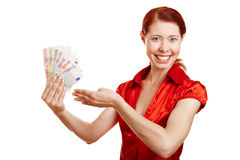 Happy woman offering Euro money Stock Photo