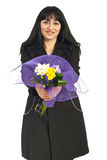 Happy woman offering freesia  bouquet Royalty Free Stock Images