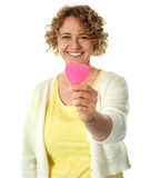 Happy woman offering her heart Stock Images