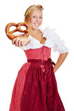 Happy woman offering pretzel Royalty Free Stock Photo
