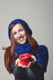 Woman holding red present Stock Photography