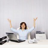 Happy woman in the office Stock Images