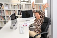 Happy woman at the office Stock Images