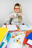 Happy woman at office drinking hot coffee Royalty Free Stock Images
