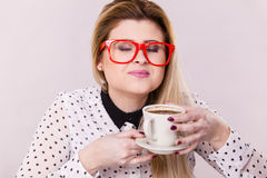 Happy woman at office drinking hot coffee Royalty Free Stock Photo