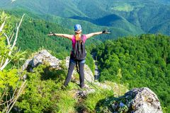 Free Happy Woman On The Mountain Ridge Called `Pietrele Negre` In Apuseni Mountains, Romania, Enjoying The View From A Via Ferrata Stock Images - 145749424