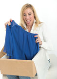 Happy woman with online clothes purchase Royalty Free Stock Photos
