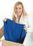 Happy woman with online clothes purchase stock photos