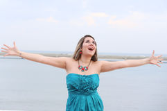 Happy woman with open arms looking at the sky Royalty Free Stock Photography