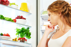 Happy woman and open refrigerator with fruits, vegetables and he Royalty Free Stock Photo