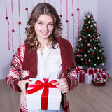 Happy woman opening christmas present box in decorated room Royalty Free Stock Images