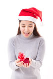 Happy woman opening christmas red gift box Royalty Free Stock Photo