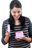 Happy woman opening a gift box Royalty Free Stock Photos