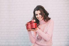 Happy woman opening a gift box. Stock Image