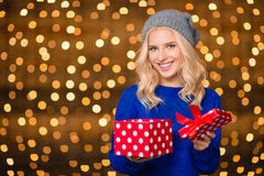 Happy woman opening gift box over holdays lights Stock Images