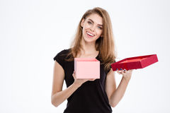 Happy woman opening gift box. Portrait of a happy woman opening gift box isolated on a white background Royalty Free Stock Image