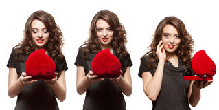 Happy woman opening a gift on Valentine's Day stock images