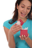 Happy Woman Opening Present. Woman opening a surprise gift Royalty Free Stock Images