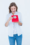Happy woman opening a present. On white background Stock Photo