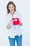 Happy woman opening a present. On white background Royalty Free Stock Image