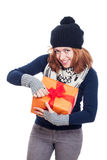 Happy woman opening present Stock Photo