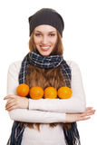 Happy woman with orange Royalty Free Stock Photography