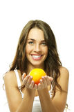 Happy woman with a orange Stock Images