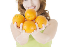 Happy woman with orange fruits Royalty Free Stock Photography