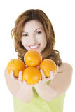 Happy woman with orange fruits Stock Photo