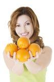 Happy woman with orange fruits Stock Photo