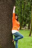 Happy woman in orange jacket Royalty Free Stock Photos