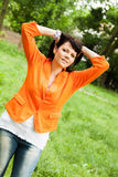 Happy woman in orange jacket Royalty Free Stock Image