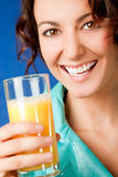Happy woman orange juice Stock Photos